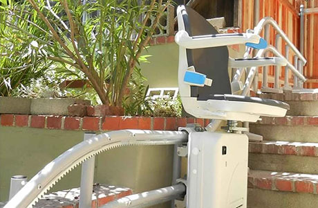 Outdoor curved stairlift with Freedom Stairlifts